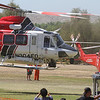 "AMERICAN HERO AIR SHOW HANSEN DAM : As more than a dozen helicopters -- from military Blackhawks to a KNBC Channel 4 news chopper -- rested on the grass at Hansen Dam Recreation Area on Saturday, hundreds of people checked them out, inspecting them almost like they would a new car. Kids clamored into the pilot's seat and posed for pictures behind mounted machine guns. Parents gazed at the instruments and talked about family members who were serving in the Army. And pilots from U.S. Air Force, the Los Angeles County Sheriff's Department, the Los Angeles Police Department, Los Angeles Fire Department and other groups talked about their jobs. That was the scene at the American Heroes Air Show, an annual event that celebrates the role of helicopters in law enforcement, the military and other uses. Everyone had questions. Do television reporters in news helicopters, following a car chase, relay inside information to police about the pursuit because the reporters have a bird's-eye view? Yup.     How much does an Air Force HH-60 Pavehawk helicopter cost? $22 million.     And what can residents do about those noisy paparazzi helicopters? Complain to your congressman.  The event was started by pilots two decades ago in Los Angeles, and has now expanded to four other cities. Glen Warren, spokesman for the American Heroes Air Show, said it's important for the public to put a face to the pilots. ""It's about raising awareness about helicopters.     Most people can't access them, can't walk up to a helicopter at the airport.""    At the Air Show, however, both the pilots and the helicopters are accessible. Last year's L.A. event was canceled due to the Carmageddon 405 Freeway closure, causing a bigger turnout this year, according to some attendees. While most of the aircraft remained grounded for the public to get up close with them, a few performed aerial maneuvers for the crowd. Families on the grass watched a trio of parachuters drop from a helicopter. More adventurous spectators paid $45 to fly up in a helicopter for a quick spell. And representatives from groups including the Secret Service and Transportation Security Administration manned booths, passing out buttons and pamphlets.  Photos by Juan Guerra."