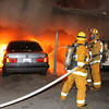 LAFD ARSON FIRES II : Los Angeles Fire Capt. Jaime Moore says authorities have detained ``a person of interest'' on Sunset Boulevard in connection with the more than 50 suspected arson fires in the Los Angeles area since Dec. 30. He did not know whether that person matched the description of the man shown Sunday on the surveillance video of a ``person of interest'' released this weekend. The announcement follows 12 new fires since 1 a.m. today in carports around Hollywood, the Hollywood Hills, Sherman Oaks and the city of West Hollywood.  Photos by Juan Guerra.