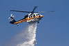 LACoFD EMMA IC  BRUSH FIRE : AGUA DULCE - A fire that burned 32 acres of brush today and damaged a bridge just off the Antelope Valley (14) Freeway near Agua Dulce Canyon has been fully contained, a county fire official said. The fire was reported at 2:47 p.m. on Agua Dulce Canyon Road at the Antelope Valley (14) Freeway, Mark Savage of the Los Angeles County Fire Department said   Initially, it threatened structures and the blaze was considered a three- alarm fire just before 4 p.m., Savage said.      By 4:30 p.m., firefighters were getting the upper hand on the flames and structures were no longer threatened. ``Things are looking good,'' Savage said. ``We will be here all night long mopping up hot spots.'      Firefighters had full containment of the blaze as of 6 p.m., he said.  No injuries were reported and no structures were damaged.     A bridge just off the 14 was affected at Agua Dulce Canyon.      ``There may be some possible structural damage to the bridge, so public works has been called out,'' Savage said. Traffic on the 14 was reduced to just one northbound lane at first, but two lanes were later opened.    Photos by Juan Guerra - VPP Photographer     (July 9, 2011)